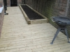 Pine decking and plant bed